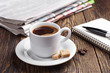 Coffee, newspaper and notepad