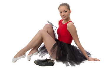 Photo of ballerina sitting on the floor
