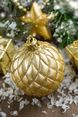 Christmas composition with golden ball and bokeh