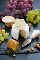delicious Camembert with fresh honey, grapes and nuts