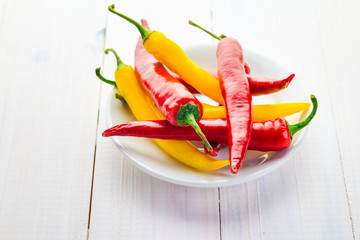 Red yellow chili peppers served plate