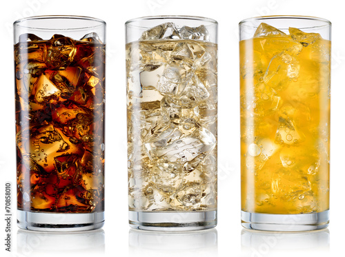 Glass of cola, fanta, sprite with ice cubes isolated on white. W