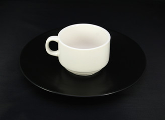 Cup and saucer on black background