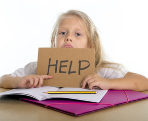 young schoogirl holding help sign in stress with homework