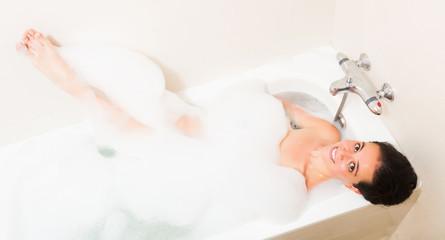 Beautiful girl laying in bathtub