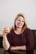 canvas print picture - Frau trinkt Orangensaft