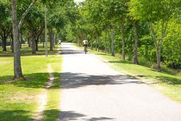bicyclists riding on a bike path