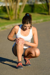 Female athlete suffering knee joint  sport injury