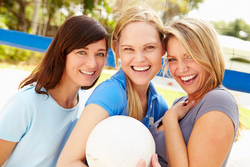Group Of Young Women Playing Volleyball Match