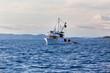 Leinwandbild Motiv Old fishing boat in Adriatic sea