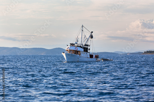 Old fishing boat in Adriatic sea - 70860403
