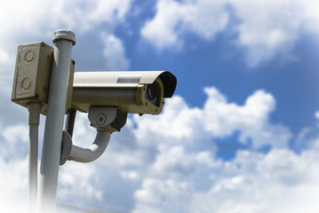 CCTV security camera under blue sky
