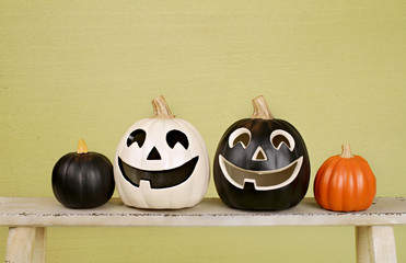 Halloween Pumpkins on Rustic Wood Bench