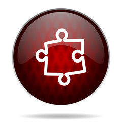 puzzle red glossy web icon on white background.