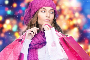 woman in winter clothes with pink shopping bags