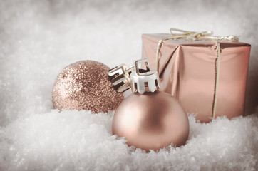 Pale Pink Christmas Decorations in Snow