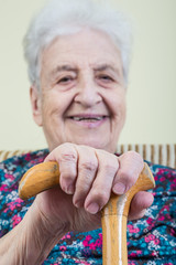 happy senior woman holding cane