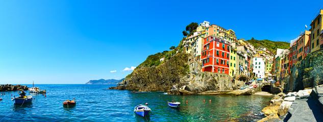 Riomaggiore village panorama, rocks, boats and sea. Cinque Terre