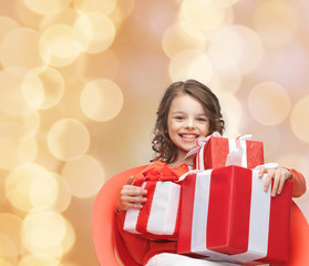smiling little girl with gift boxes