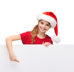 child in santa helper hat with blank white board