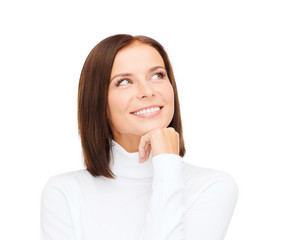 thinking and smiling woman in white sweater