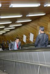 Running up an escalator going down