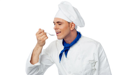 Male chef tasting the food