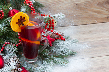 mulled wine with decorated christmas tree