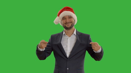 young businessman in a hat santa claus shows copy space