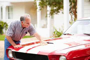 Retired Senior Man Cleaning Restored Car