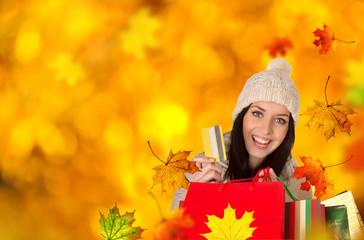 Young beautiful woman, autumn shopping.