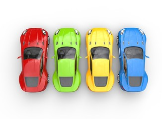 Top view on row of multicolored cars on white background