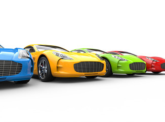 Row of multicolored cars on white background