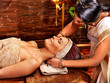 Woman having Ayurvedic spa treatment.