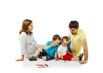 Happy family in studio drawing