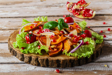 salad of roasted pumpkin and pomegranate cherry tomatoes