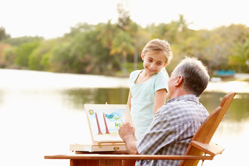 Grandfather With Granddaughter Outdoors Painting Landscape