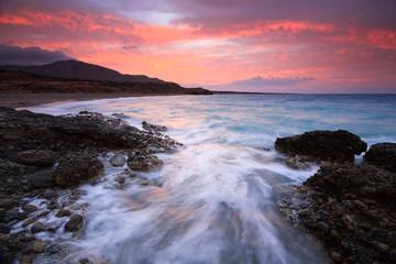 Winter sunset over a rough sea in Crete, Greece.