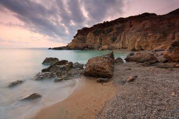 Sunset on a beach in Crete, Greece.
