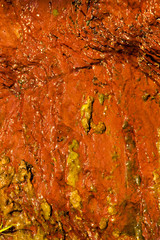 Background natural wet orange stone wall texture