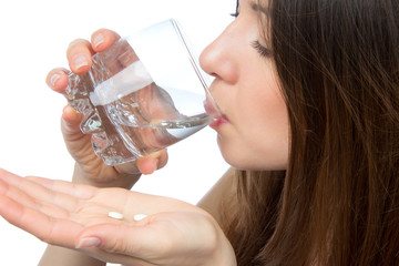 Woman with headache hand take pill medicine tablet and glass of