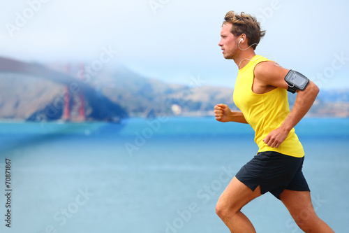 Leinwanddruck Bild Athlete running man - male runner in San Francisco