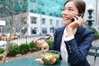 Young business woman on smartphone in lunch break