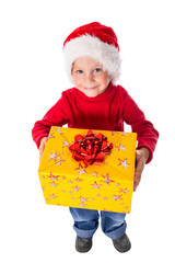 Little boy in christmas hat with gift box