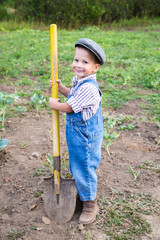 Little boy with shovel on field