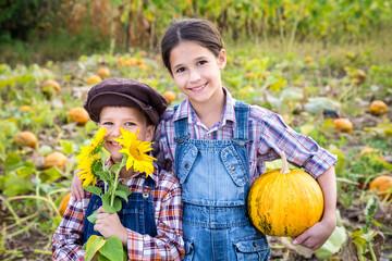 Two kids in vegetable garden