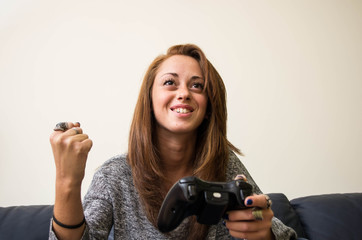 girl is playing with a video game