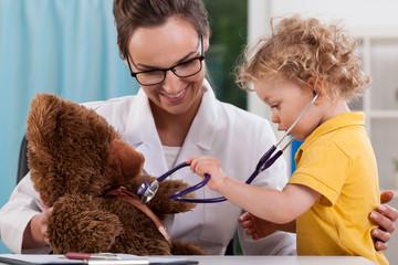 Child auscultating teddy bear