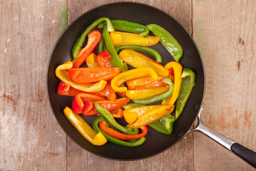 chopped peppers in frying pan