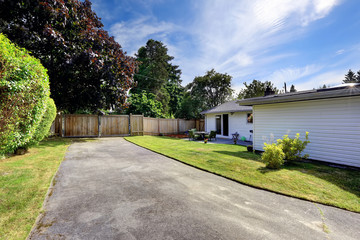 House exterior with fence and driveway